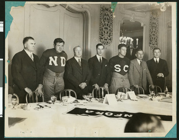 1927 dinner with the players before the game; standing left to right: Glenn Pop Warner, Babe Ruth, Knute Rockne, Christy Walsh, Lou Gehrig, Howard Jones, Tad Joneses