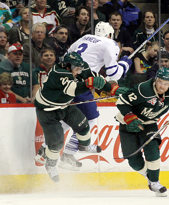 ST PAUL, MN - MARCH 22: Cal Clutterbuck #22 of the Minnesota Wild hits Dion Phaneuf #3 of the Toronto Maple Leafs at the Xcel Energy Center on March 22, 2011 in St Paul, Minnesota.  (Photo by Bruce Bennett/Getty Images)
