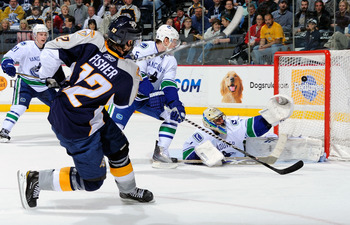 NASHVILLE, TN - MARCH 29:  Mike Fisher #12 of the Nashville Predators scores a goal on Roberto Luongo #1 of the Vancouver Canucks on March 29, 2011 at the Bridgestone Arena in Nashville, Tennessee.  (Photo by Frederick Breedon/Getty Images)