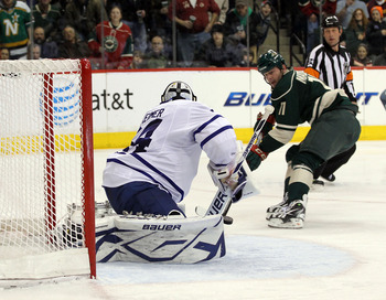 ST PAUL, MN - MARCH 22: John Madden #11 of the Minnesota Wild is stopped on a second period breakaway by James Reimer #34 of the Toronto Maple Leafs  at the Xcel Energy Center on March 22, 2011 in St Paul, Minnesota. (Photo by Bruce Bennett/Getty Images)