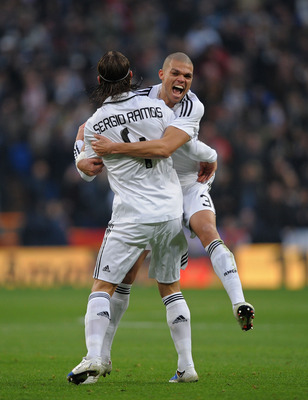 MADRID, SPAIN - JANUARY 18:  Sergio Ramos of Real Madrid celebrates with Pepe after scoring Real's first goal against Osasuna during the La Liga match between Real Madrid and Osasuna on January 18, 2009 in Madrid, Spain.  (Photo by Denis Doyle/Getty Image