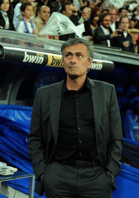 MADRID, SPAIN - APRIL 16: Head coach Jose Mourinho of Real Madrid waits for the start of the La Liga match between Real Madrid and Barcelona at Estadio Santiago Bernabeu on April 16, 2011 in Madrid, Spain.  (Photo by Denis Doyle/Getty Images)