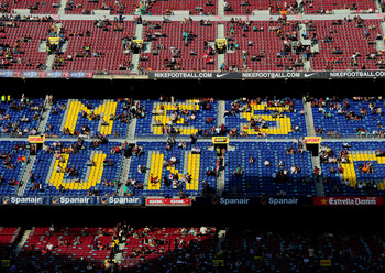 BARCELONA, SPAIN - APRIL 09:  FC Barcelona fans find their seats lit in late afternoon sunlight prior to the start of the la Liga match between FC Barcelona and UD Almeria at the Camp Nou stadium on April 9, 2011 in Barcelona, Spain.  (Photo by Jasper Jui