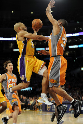 LOS ANGELES, CA - MAY 19:  Derek Fisher #2 of the Los Angeles Lakers goes up for a shot as Grant Hill #33 of the Phoenix Suns defends in the third quarter of Game Two of the Western Conference Finals during the 2010 NBA Playoffs at Staples Center on May 1