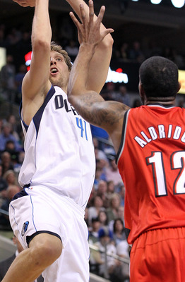 DALLAS, TX - APRIL 16:  Forward Dirk Nowitzki #41 of the Dallas Mavericks takes a shot against LaMarcus Aldridge #12 of the Portland Trail Blazers in Game One of the Western Conference Quarterfinals during the 2011 NBA Playoffs on April 16, 2011 at Americ