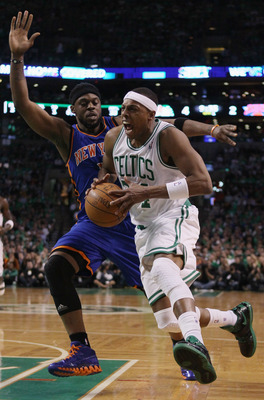 BOSTON, MA - APRIL 17:  Paul Pierce #34 of the Boston Celtics heads for the net as Bill Walker #5 of the New York Knicks defends in Game One of the Eastern Conference Quarterfinals in the 2011 NBA Playoffs on April 17, 2011 at the TD Garden in Boston, Mas