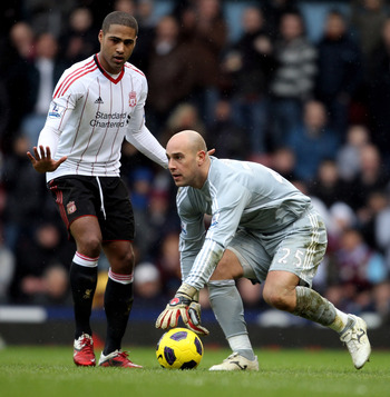 LONDON, ENGLAND - FEBRUARY 27:  Glen Johnson (L) and Pepe Reina of Liverpool in action during the Barclays Premier League match between West Ham United and Liverpool at the Boleyn Ground on February 27, 2011 in London, England.  (Photo by Scott Heavey/Get