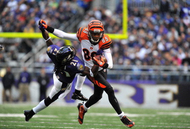 BALTIMORE, MD - JANUARY 2:  Jerome Simpson #89 of the Cincinnati Bengals runs the ball against Lardarius Webb #21 of the Baltimore Ravens at M&T Bank Stadium on January 2, 2011 in Baltimore, Maryland. The Ravens lead the Bengals 6-0 at the half. (Photo by