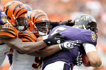 CINCINNATI - SEPTEMBER 19: Michael Johnson #93 and Geno Atkins #97 of the Cincinatti Bengals sack quarterback Joe Flacco #5 of the Baltimore Ravens at Paul Brown Stadium on September 19, 2010 in Cincinnati, Ohio.  (Photo by Matthew Stockman/Getty Images)