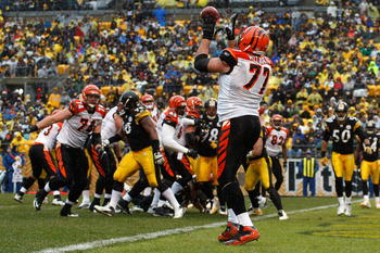PITTSBURGH - DECEMBER 12:  Andrew Whitworth #77 of the Cincinnati Bengals catches a touchdown pass against the Pittsburgh Steelers during the game on December 12, 2010 at Heinz Field in Pittsburgh, Pennsylvania.  (Photo by Jared Wickerham/Getty Images)