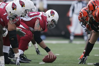 CINCINNATI - NOVEMBER 18:  Al Johnson #50 of the Arizona Cardinals crouches into position at the line of scrimmage during the NFL game against the Cincinnati Bengals at Paul Brown Stadium on November 18, 2007 in Cincinnati, Ohio. (Photo by Andy Lyons/Gett