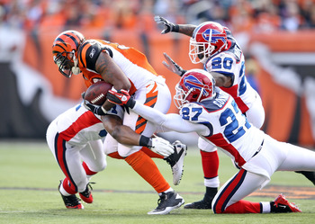 CINCINNATI - NOVEMBER 21:  Cedric Benson #32 of the Cincinnati Bengals is tackled by Jarius Byrd #31, Reggie Corner #27  and Donte Whitner #20 of the Buffalo Bills during the NFL game at Paul Brown Stadium on November 21, 2010 in Cincinnati, Ohio.  (Photo