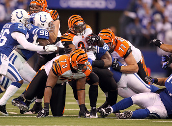 INDIANAPOLIS - NOVEMBER 14:  Cedric Benson #32 of the Cincinnati Bengals runs with the ball  during the Bengals 23-17 loss to the Indianapolis Colts in the NFL game at Lucas Oil Stadium on November 14, 2010 in Indianapolis, Indiana.  (Photo by Andy Lyons/