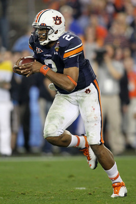 GLENDALE, AZ - JANUARY 10:  Cameron Newton #2 of the Auburn Tigers runs down field against the Oregon Ducks during the Tostitos BCS National Championship Game at University of Phoenix Stadium on January 10, 2011 in Glendale, Arizona.  (Photo by Jonathan F