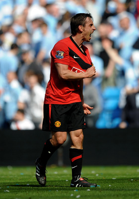 MANCHESTER, UNITED KINGDOM - APRIL 17:  Gary Neville of Manchester United celebrates at the end of  the Barclays Premier League match between Manchester City and Manchester United at the City of Manchester Stadium on April 17, 2010 in Manchester, England.