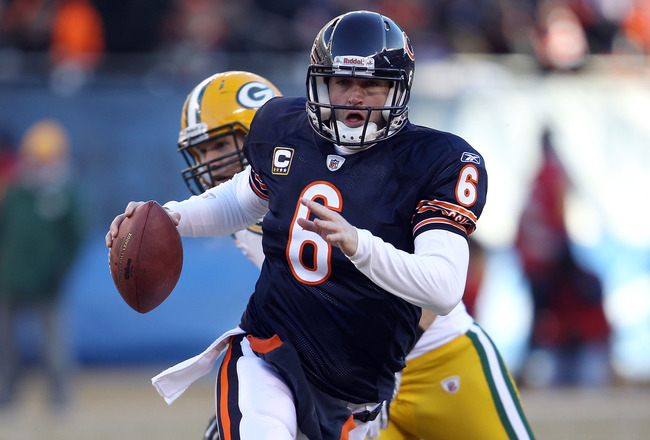 CHICAGO, IL - JANUARY 23:  Quarterback Jay Cutler #6 of the Chicago Bears runs the ball ahead of Clay Matthews #52 of the Green Bay Packers in the second quarter of the NFC Championship Game at Soldier Field on January 23, 2011 in Chicago, Illinois.  (Pho