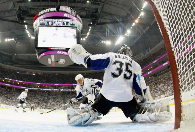 PITTSBURGH, PA - APRIL 15:  Goalie Dwayne Roloson#35 of the Tampa Bay Lightning blocks the net during Game Two of the Eastern Conference Quarterfinals against the  Pittsburgh Penguins during the 2011 NHL Stanley Cup Playoffs at Consol Energy Center on Apr