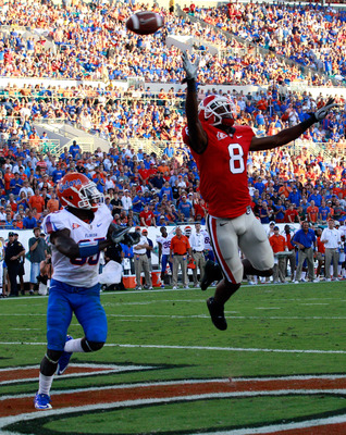 JACKSONVILLE, FL - OCTOBER 30:  A.J. Green #8 of the Georgia Bulldogs attempts to catch a pass against Ahmad Black #35 of the Florida Gators during the game at EverBank Field on October 30, 2010 in Jacksonville, Florida.  (Photo by Sam Greenwood/Getty Ima