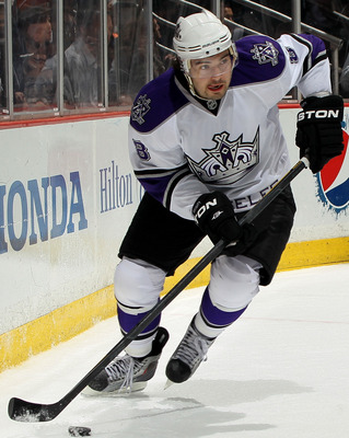 ANAHEIM, CA - APRIL 8:  Drew Doughty #8 of the Los Angeles Kings skates with the puck against the Anaheim Ducks at Honda Center on April 8, 2011 in Anaheim, California.   (Photo by Stephen Dunn/Getty Images)