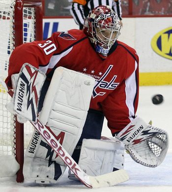 WASHINGTON, DC - APRIL 15:  Michal Neuvirth #30 of the Washington Capitals makes the save against the New York Rangers in Game Two of the Eastern Conference Quarterfinals during the 2011 NHL Stanley Cup Playoffs at Verizon Center on April 15, 2011 in Wash