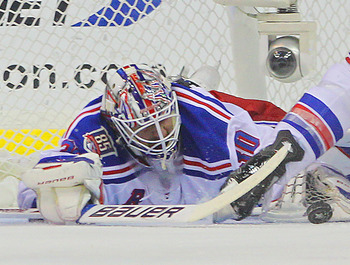 WASHINGTON, DC - APRIL 15:  Henrik Lundqvist #30 of the New York Rangers makes the first period save against the Washington Capitals in Game Two of the Eastern Conference Quarterfinals during the 2011 NHL Stanley Cup Playoffs at Verizon Center on April 15
