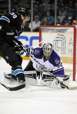 SAN JOSE, CA - APRIL 16: Jonathan Quick #32 of the Los Angeles Kings makes a glove hand save in front of Logan Couture #39 of the San Jose Sharks in Game Two of the Western Conference Quarterfinals  during the 2011 NHL Stanley Cup Playoffs at the HP Pavil