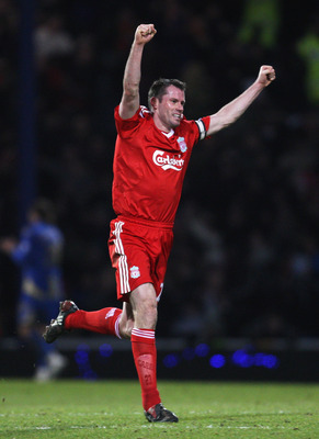 PORTSMOUTH, UNITED KINGDOM - FEBRUARY 07: Jamie Carragher of Liverpool celebrates Fernando Torres' winning goal during the Barclays Premier League match between Portsmouth and Liverpool at Fratton Park on February 7, 2009 in Portsmouth, England.  (Photo b