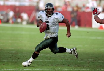 5 Dec 1999: Donovan McNabb #5 of the Philadelphia Eagles runs with the ball during a game against the  Arizona Cardinals at the Sun Devil Stadium in Tempe, Arizona. The Cardinals defeated the Eagles 21-17. Mandatory Credit: Harry How  /Allsport