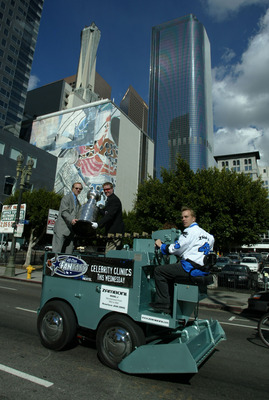 29 Jan 2002:  The Stanley Cup is driven around downtown Los Angeles aboard a 1965 Model J Zamboni with Butch Goring (L) and the Mike Bolt (C), a hockey Hall of Fame employee called the 'Keeper of the Cup.' The Parade was the opening event of the NHL All S
