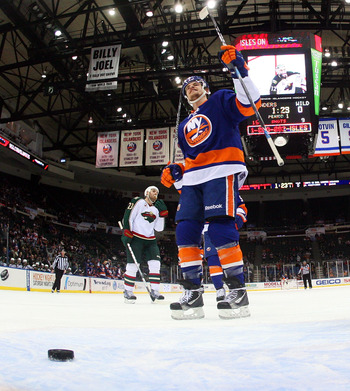 UNIONDALE, NY - MARCH 02: Michael Grabner #40 of the New York Islanders celebrates a goal against the Minnesota Wild at the Nassau Coliseum on March 2, 2011 in Uniondale, New York. The Islanders defeated the Wild 4-1.  (Photo by Bruce Bennett/Getty Images