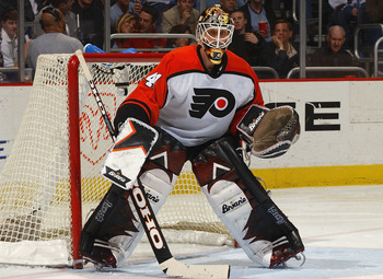 WASHINGTON - MARCH 6:  Goalie Sean Burke #41 of the Philadelphia Flyers protects the net during the game against the Washington Capitals at the MCI Center on March 6, 2004 in Washington, DC. The Capitals defeated the Flyers 2-1. (Photo by Mitchell Layton/