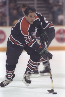 17 Jan 1997:  Reed Larson of the NHL moves the puck during the Heroes of Hockey game against California at the San Jose Arena in San Jose, California.  The NHL won the game, 4-3. Mandatory Credit: Jamie Squire  /Allsport