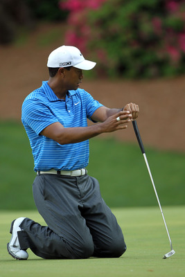 AUGUSTA, GA - APRIL 09:  Tiger Woods reacts to a missed putt on the 13th green during the third round of the 2011 Masters Tournament at Augusta National Golf Club on April 9, 2011 in Augusta, Georgia.  (Photo by Jamie Squire/Getty Images)