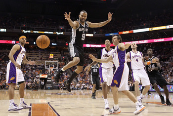 PHOENIX, AZ - APRIL 13:  Tony Parker #9 of the San Antonio Spurs looses the ball as he drives to the net past Steve Nash #13 of the Phoenix Suns during the NBA game at US Airways Center on April 13, 2011 in Phoenix, Arizona.  NOTE TO USER: User expressly