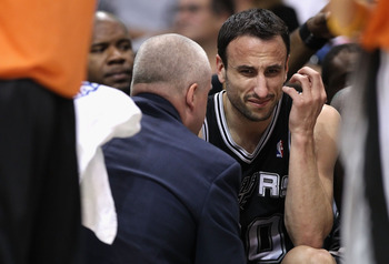 PHOENIX, AZ - APRIL 13:  Manu Ginobili #20 of the San Antonio Spurs reacts on the bench after an injury in the NBA game against the Phoenix Suns at US Airways Center on April 13, 2011 in Phoenix, Arizona.  NOTE TO USER: User expressly acknowledges and agr