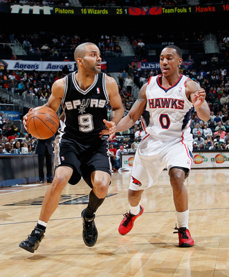 ATLANTA, GA - APRIL 05:  Tony Parker #9 of the San Antonio Spurs against Jeff Teague #0 of the Atlanta Hawks at Philips Arena on April 5, 2011 in Atlanta, Georgia.  NOTE TO USER: User expressly acknowledges and agrees that, by downloading and/or using thi