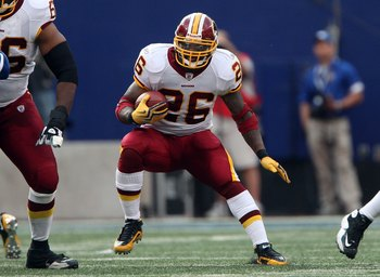 EAST RUTHERFORD, NJ - SEPTEMBER 13:  Clinton Portis #26 of the Washington Redskins runs the ball against the New York Giants on September 13, 2009 at Giants Stadium in East Rutherford, New Jersey.  (Photo by Jim McIsaac/Getty Images)