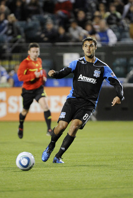 SANTA CLARA, CA - APRIL 2: Chris Wondolowski #8 of the San Jose Earthquakes dribbles the ball up field against the Seattle Sounders FC during an MLS soccer game at Buck Shaw Stadium on April 2, 2011 in Santa Clara, California. The game ended in a 2-2 tie.