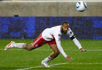 HARRISON, NJ - APRIL 16:  Thierry Henry #14 of the New York Red Bulls heads the ball into the net past goalkeeper Jon Busch #18 of the San Jose Earthquakes for a second half goal during the game at Red Bull Arena on April 16, 2011 in Harrison, New Jersey.