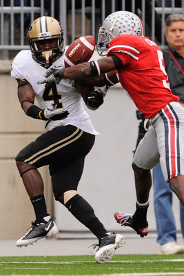 COLUMBUS, OH - OCTOBER 23:  Chimdi Chekwa #5 of the Ohio State Buckeyes breaks up a pass intended for O.J. Ross #4 of the Purdue Boilermakers at Ohio Stadium on October 23, 2010 in Columbus, Ohio.  (Photo by Jamie Sabau/Getty Images)