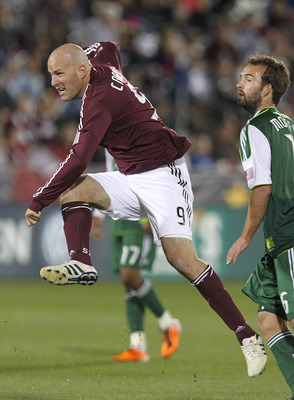COMMERCE CITY, CO - MARCH 19:  Conor Casey #9 of the Colorado Rapids puts a shot on goal against the Portland Timbers at Dicks Sporting Goods Park on March 19, 2011 in Commerce City, Colorado. The Rapids defeated the Timbers 3-1.  (Photo by Michael Martin