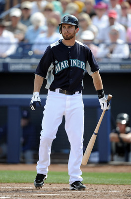 PEORIA, AZ - MARCH 01:  Dustin Ackley #13 of the  Seattle Mariners at bat against the Texas Rangers during spring training at Peoria Stadium on March 1, 2011 in Peoria, Arizona.  (Photo by Harry How/Getty Images)