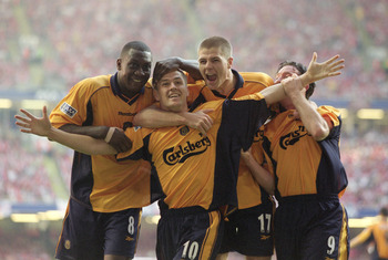 12 May 2001:  Michael Owen of Liverpool celebrates his equaliser with team mates Emile Heskey, Steven Gerrard and Robbie Fowler in the AXA Sponsored FA Cup Final against Arsenal at the Millennium Stadium in Cardiff, Wales. Liverpool won 2-1. \ Mandatory C