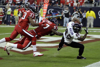 HOUSTON, TX - DECEMBER 13:  Wide receiver Derrick Mason #85 of the Baltimore Ravens scores in the first half against the Houston Texans as linebacker Kevin Bentley #57 and Troy Nolan #33 of the Houston Texans are late defending at Reliant Stadium on Decem