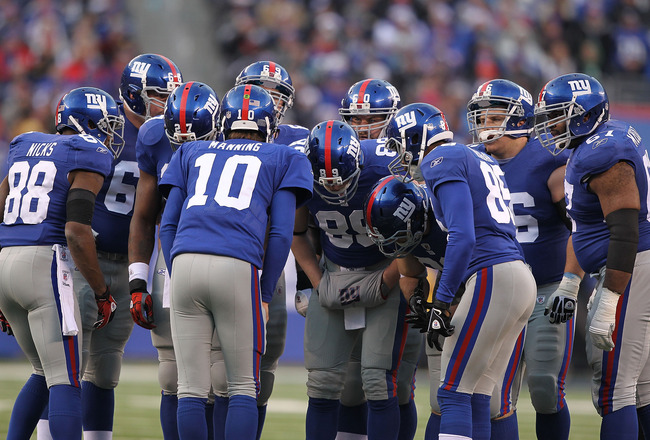 EAST RUTHERFORD, NJ - DECEMBER 19:  Eli Manning #10 of the New York Giantscalls the huddle against  the Philadelphia Eagles during their game on December 19, 2010 at The New Meadowlands Stadium in East Rutherford, New Jersey.  (Photo by Al Bello/Getty Ima
