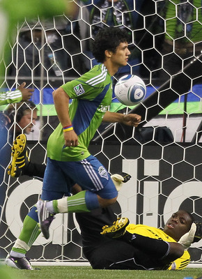 SEATTLE - AUGUST 28:  Fredy Montero #17 of the Seattle Sounders FC runs past goalkeeper Sean Johnson #25 after scoring the second goal against the Chicago Fire on August 28, 2010 at Qwest Field in Seattle, Washington.  (Photo by Otto Greule Jr/Getty Image