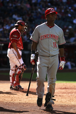 PHOENIX, AZ - APRIL 10:  Edgar Renteria #16 of the Cincinnati Reds walks back to the dugout after striking out against the Arizona Diamondbacks during the Major League Baseball game at Chase Field on April 10, 2011 in Phoenix, Arizona.  The Diamondbacks d