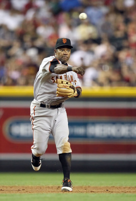 PHOENIX, AZ - APRIL 16:  Infielder Miguel Tejada #10 of the San Francisco Giants fields a ground ball out against the Arizona Diamondbacks during the Major League Baseball game at Chase Field on April 16, 2011 in Phoenix, Arizona. The Giants defeated the