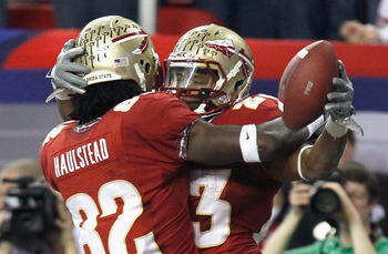 ATLANTA, GA - DECEMBER 31:  Chris Thompson #23 of the Florida State Seminoles celebrates scoring a touchdown against the South Carolina Gamecocks with Willie Haulstead #82 during the 2010 Chick-fil-A Bowl at Georgia Dome on December 31, 2010 in Atlanta, G