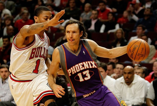 CHICAGO - MARCH 30: Steve Nash #13 of the Phoenix Suns drives around Derrick Rose #1 of the Chicago Bulls at the United Center on March 30, 2010 in Chicago, Illinois. The Suns defeated the Bulls 111-105. NOTE TO USER: User expressly acknowledges and agree